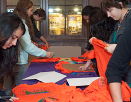 Volunteers prepare shirts for Home Lost quilts